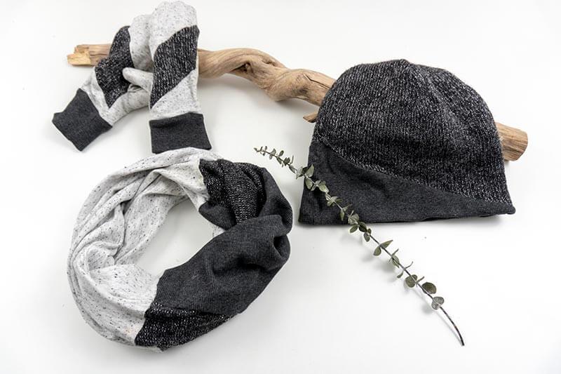 schwarz graues Winterset zum Wenden und drapieren, bestehend aus Mütze, Handschuhen und Schal